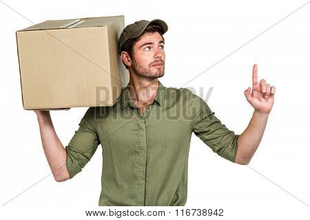 Handsome postman holding pack looking up on white screen