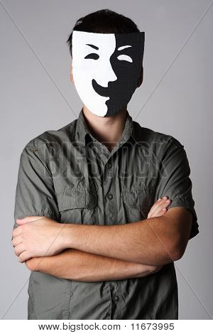 Man In Theater Black And White Smiling Mask Standing With Crossed Hands