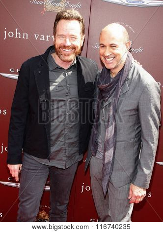 John Varvatos and Bryan Cranston at the John Varvatos 9th Annual Stuart House Benefit Presented By Chrysler And Hasbro held at the John Varvatos Boutique, California, United States on March 11, 2012.