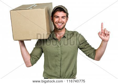 Handsome postman holding pack pointing up on white screen