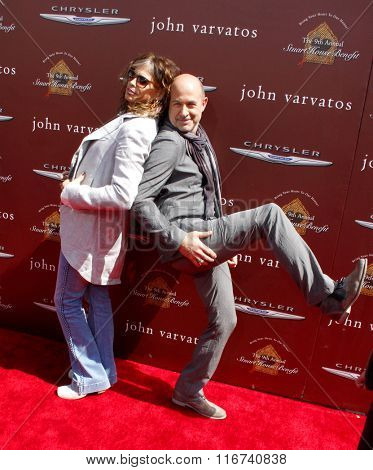 Steven Tyler and John Varvatos at the John Varvatos 9th Annual Stuart House Benefit Presented By Chrysler And Hasbro held at the John Varvatos Boutique, California, United States on March 11, 2012.