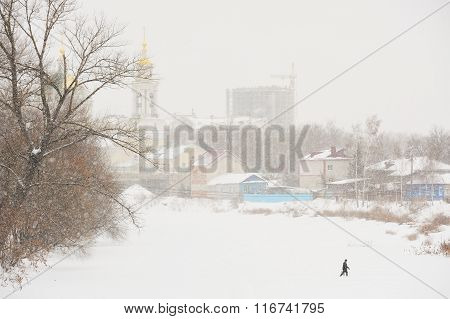 Man Crossing Ice Covered River