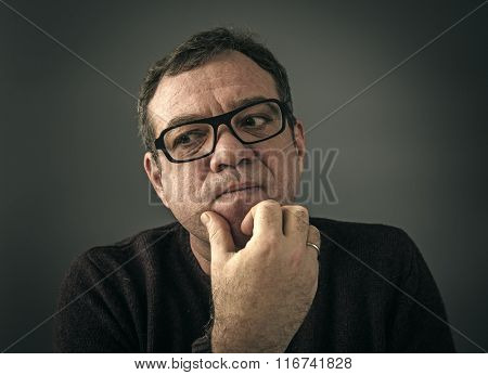 Surprised man with glasses. Low-key style photo