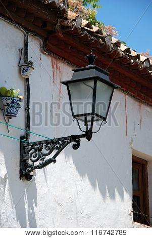 Spanish streetlight on townhouse, Granada.