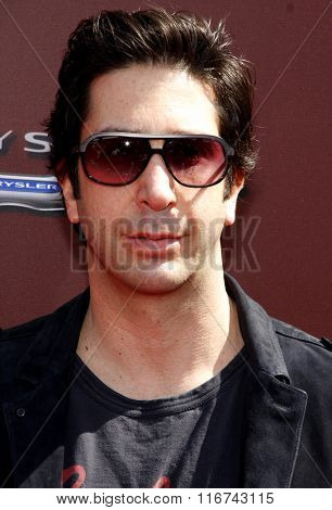 David Schwimmer at the John Varvatos 9th Annual Stuart House Benefit Presented By Chrysler And Hasbro held at the John Varvatos Boutique, California, United States on March 11, 2012.