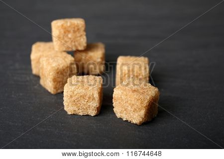 Pile of brown sugar cubes on the table