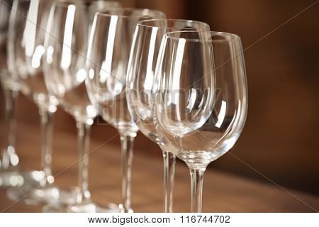 Set of empty wineglasses on wooden table