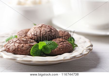 Chocolate chip cookie with mint on light background