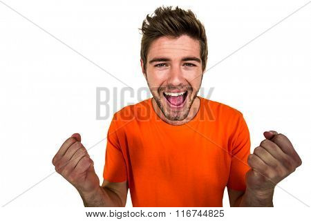 Portrait of excited man with hands clasped on white screen