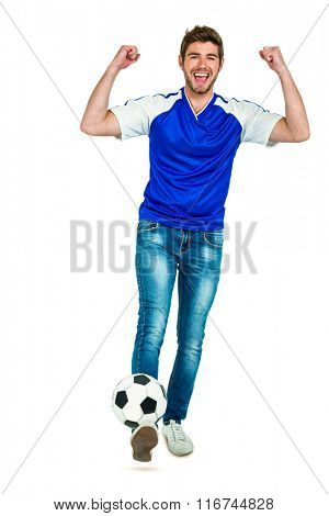Smart man holding football with arms raised on white screen