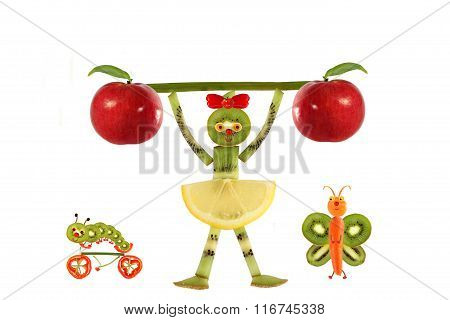 Creative Food Concept. Funny Little Girl  With Slices Of Kiwi.