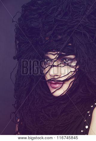 Woman in head wear of black threads