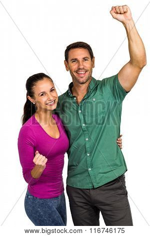 Triumphant couple raising fists on white screen