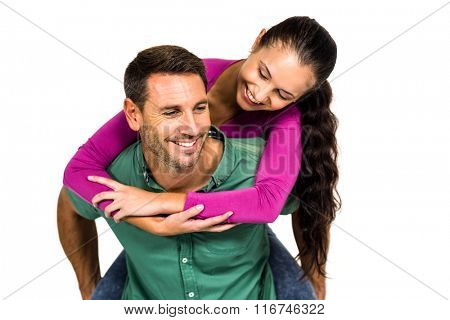 Man with piggy back to his girlfriend on white screen