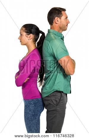 Couple standing back to back after argument on white screen
