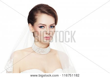 Young beautiful bride with stylish make-up and bridal veil over white background, copy space