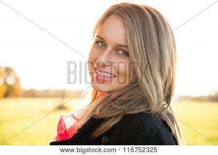 Beautiful woman  portrait in autumnal park