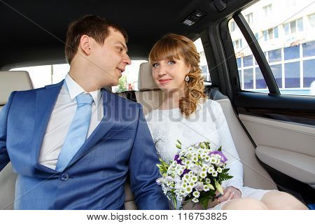 Young Happy Couple On The Way To Registry Office