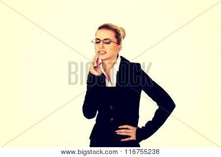 Young businesswoman suffering from toothache