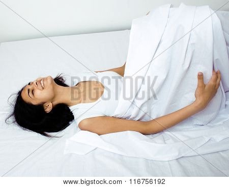 pretty mulatto brunette woman in bed, cant sleep white shits depressed close up