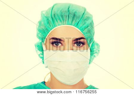 Female surgeon doctor in protective mask