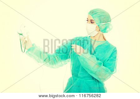Young anesthesiologist woman holding an oxygen mask