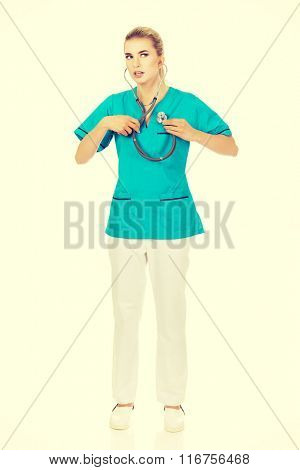 Young nursre or female doctor listen her own heart