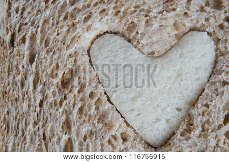 Close Up Of Brown Bread With White Heart