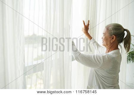 Grandmother by window