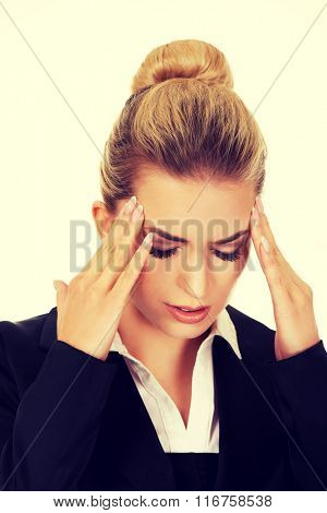 Young businesswoman having huge headache