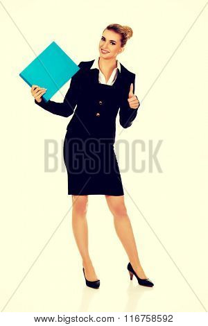 Smiling businesswoman holding a binder