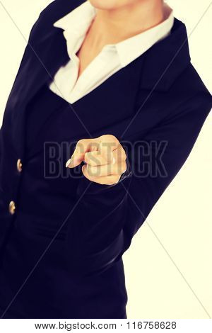 Young smiled businesswoman pointing her finger