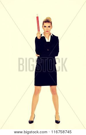 Young businesswoman pointing up with big pen