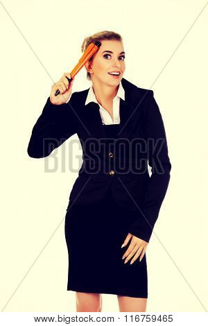 Young businesswoman with big pen