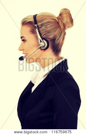 Happy young businesswoman with headset