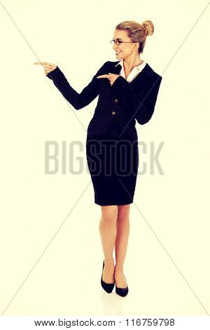Beautiful young businesswoman presenting something