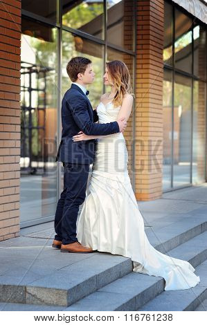 Happy Bride And Groom Walking On A Street Of City
