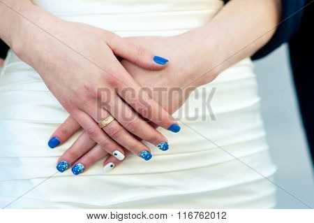Hands Of A Bride With Blue Manicure Close-up