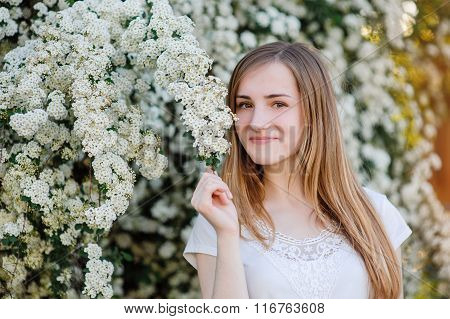 Young Naturally Beautiful Woman Near The Blooming Tree In Spring Time