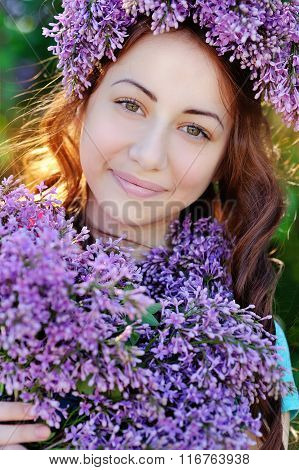 Beautiful Girl With A Bouquet Of Lilacs And A Wreath Of Lilac