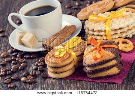 Biscuits and coffee on table