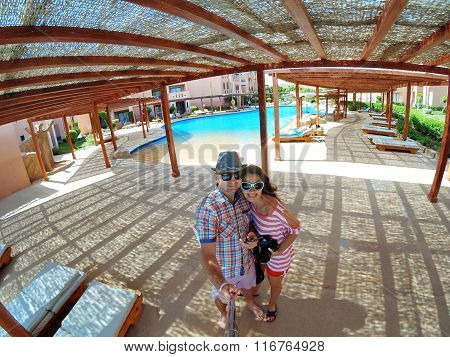 Loving Couple Making Selfy Near Swimming Pool