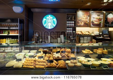 HONG KONG - JANUARY 26, 2016: interior of Starbucks cafe. Starbucks Corporation is an American global coffee company and coffeehouse chain based in Seattle, Washington