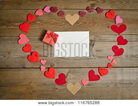 Empty Blank For Text With Gift Box Around Many Hearts Handmade  In  Shape Of Heart On The Wooden Boa