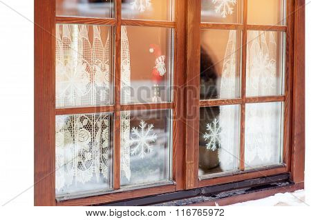 Window Decorated With Snowflakes