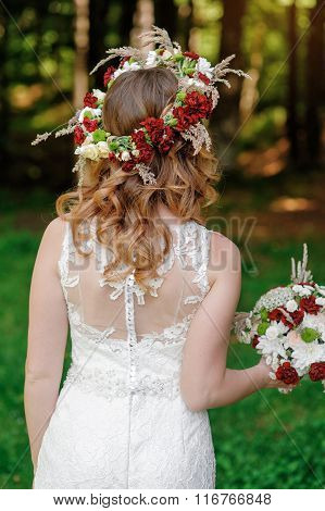 Bride holding beautiful wedding bouquet for a walk