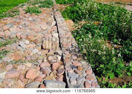 Road paved with stone, roads background and abstract
