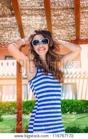 Happy Woman In Sunglasses Resting