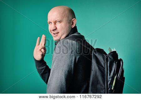 fastidious man with a backpack in studio