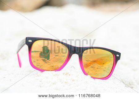 Sunglasses Lying On  The Beach.